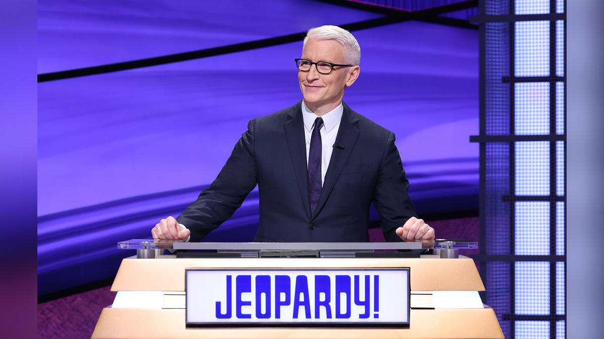 Anderson Cooper behind the Jeopardy! lectern