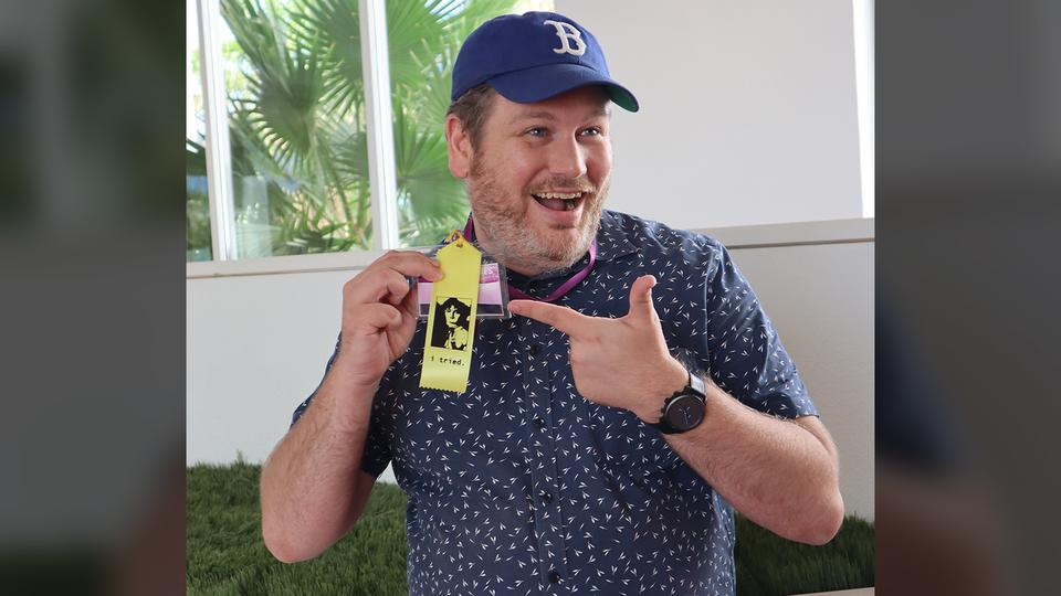 "Jason Sterlacci shows off a post-competition ""I tried"" consolation badge."